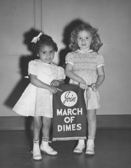 Rose Marie Waters and Linda Brown, March of Dimes poster children; 1949